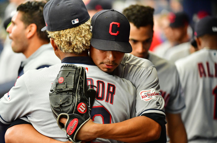 ST PETERSBURG, FLORIDA - SEPTEMBER 01: Carlos Carrasco #59 of the Cleveland Indians hugs teammate Francisco Lindor #12 after taking the big league mound for the first time since May 30 at Tropicana Field on September 01, 2019 in St Petersburg, Florida. (Photo by Julio Aguilar/Getty Images)