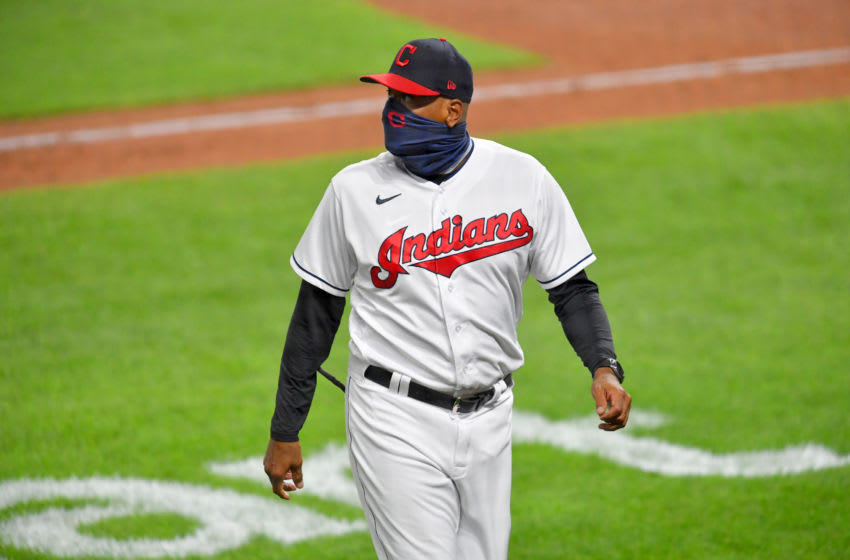 CLEVELAND, OHIO - AUGUST 21: Temporary manager Sandy Alomar Jr. of the Cleveland Indians walks back to the dugout after a pitching change during the seventh inning against the Detroit Tigers at Progressive Field on August 21, 2020 in Cleveland, Ohio. The Tigers defeated the Indians 10-5. (Photo by Jason Miller/Getty Images)