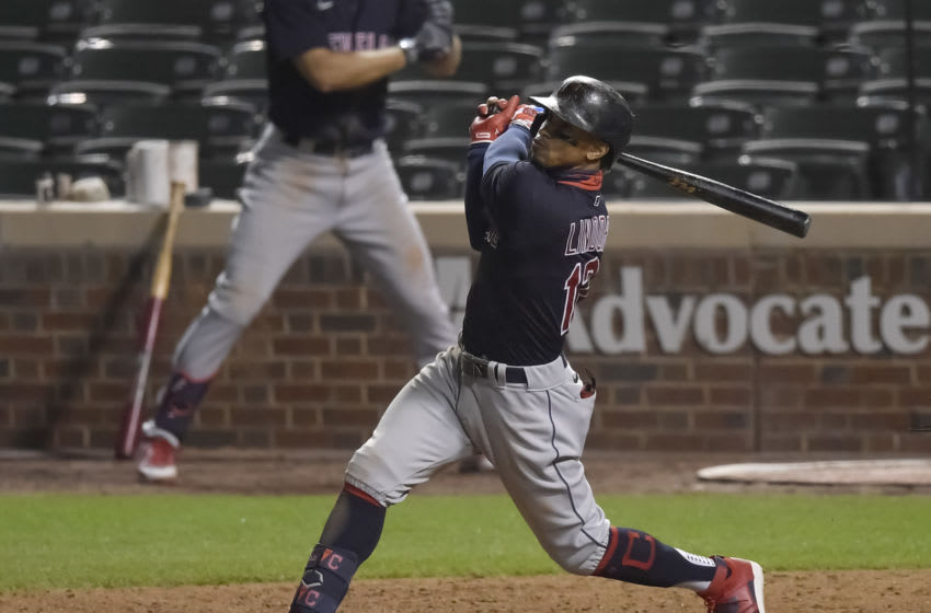 CHICAGO, ILLINOIS - SEPTEMBER 15: Francisco Lindor #12 of the Cleveland Indians hits a home run against the Chicago Cubs at Wrigley Field on September 15, 2020 in Chicago, Illinois. (Photo by Quinn Harris/Getty Images)