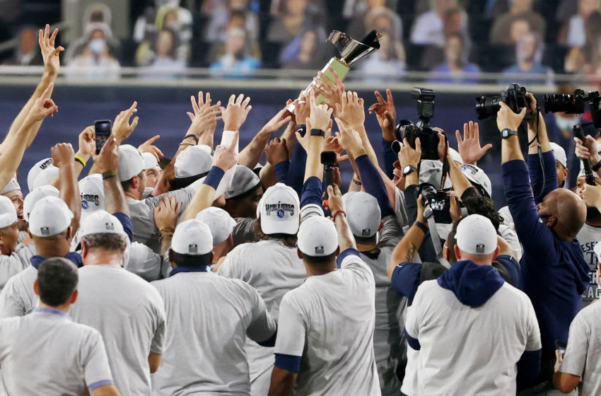 SAN DIEGO, CALIFORNIA - OCTOBER 17: Members of the Tampa Bay Rays hold the William Harridge Trophy after defeating the Houston Astros in Game Seven of the American League Championship Series at PETCO Park on October 17, 2020 in San Diego, California. (Photo by Ezra Shaw/Getty Images)