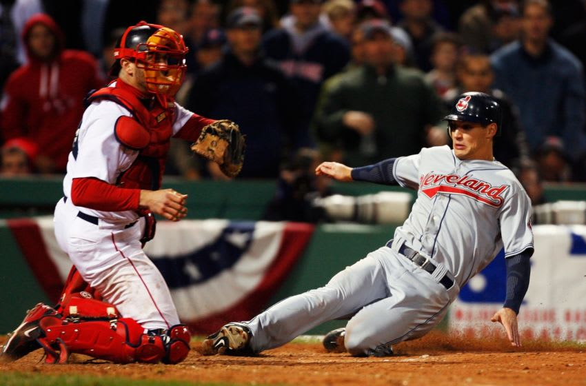 BOSTON - OCTOBER 13: Grady Sizemore #24 of the Cleveland Indians slides to home plate in front of catcher Jason Varitek #33 of the Boston Red Sox to score the go ahead run on a single by Trot Nixon #33 during Game Two of the American League Championship Series at Fenway Park on October 13, 2007 in Boston, Massachusetts. (Photo by Jim Rogash/Getty Images)