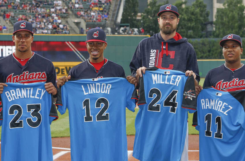 CLEVELAND, OH - JULY 09: Michael Brantley #23, Francisco Lindor #12, Andrew Miller #24 and Jose Ramirez #11 of the Cleveland Indians receive their All Star jerseys before a game against the Detroit Tigers at Progressive Field on July 9, 2017 in Cleveland, Ohio. (Photo by Ron Schwane/Getty Images)