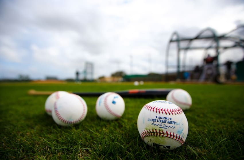 JUPITER, FL - FEBRUARY 23: Baseballs and a bat sit on the field of the Miami Marlins during a team workout on February 23, 2016 in Jupiter, Florida. (Photo by Rob Foldy/Getty Images)