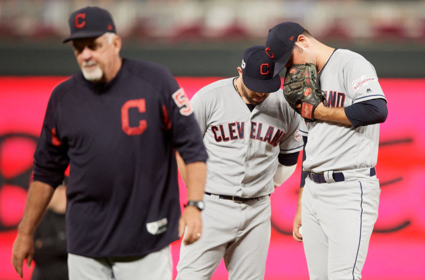 MINNEAPOLIS, MN - SEPTEMBER 06: Jason Kipnis #22 and Adam Plutko #45 of the Cleveland Indians speak after pitching coach Carl Willis #51 visited the mound during the game against the Minnesota Twins on September 6, 2019 at Target Field in Minneapolis, Minnesota. The Indians defeated the Twins 6-2 in eleven innings. (Photo by Hannah Foslien/Getty Images)
