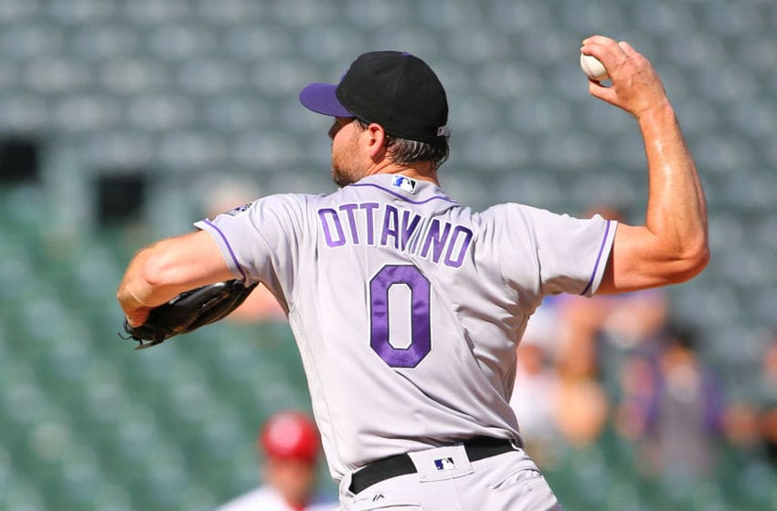 ARLINGTON, TX - AUGUST 11: Adam Ottavino #0 of the against the Colorado Rockies throws in the ninth inning against the Texas Rangers at Globe Life Park in Arlington on August 11, 2016 in Arlington, Texas. (Photo by Rick Yeatts/Getty Images)
