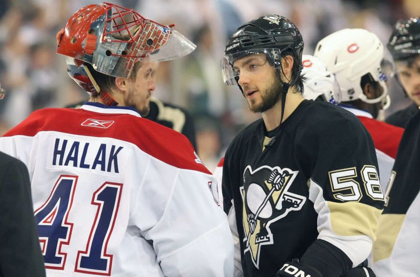 PITTSBURGH - MAY 12: Kris Letang #56 of the Pittsburgh Penguins shakes hands with Jaroslav Halak #41 of the Montreal Canadiens in Game Seven of the Eastern Conference Semifinals during the 2010 Stanley Cup Playoffs at Mellon Arena on May 12, 2010 in Pittsburgh, Pennsylvania.(Photo By Dave Sandford/Getty Images)