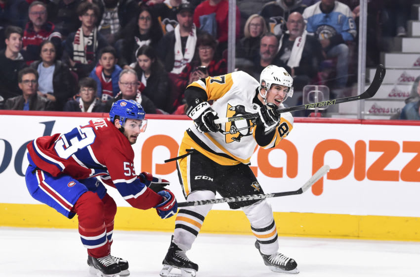 MONTREAL, QC - OCTOBER 13: Sidney Crosby #87 of the Pittsburgh Penguins shoots the puck past Victor Mete #53 of the Montreal Canadiens during the NHL game at the Bell Centre on October 13, 2018 in Montreal, Quebec, Canada. The Montreal Canadiens defeated the Pittsburgh Penguins 4-3 in a shootout. (Photo by Minas Panagiotakis/Getty Images)