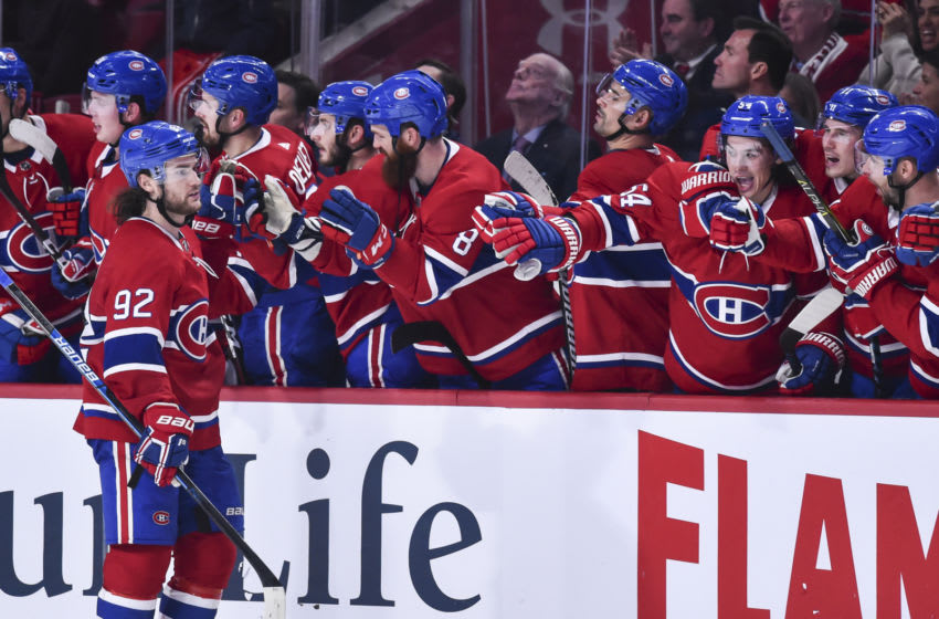 MONTREAL, QC - OCTOBER 13: Jonathan Drouin #92 of the Montreal Canadiens celebrates a shootout goal with teammates on the bench against the Pittsburgh Penguins during the NHL game at the Bell Centre on October 13, 2018 in Montreal, Quebec, Canada. The Montreal Canadiens defeated the Pittsburgh Penguins 4-3 in a shootout. (Photo by Minas Panagiotakis/Getty Images)