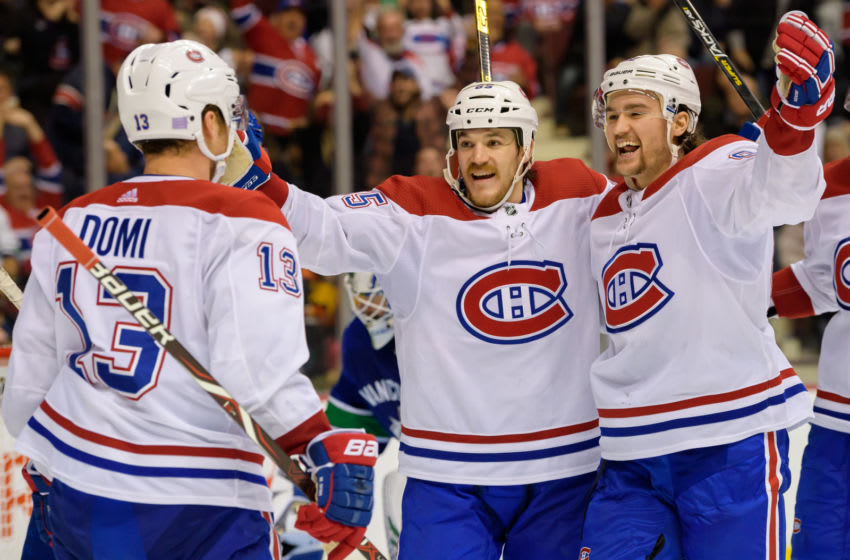 VANCOUVER, BC - NOVEMBER 17: Montreal Canadiens right Wing Andrew Shaw (65) celebrates with left Wing Jonathan Drouin (92) and center Max Domi (13) after scoring goal on Vancouver Canucks goaltender Jacob Markstrom (25) during their NHL game at Rogers Arena on November 17, 2018 in Vancouver, British Columbia, Canada. Monreal won 3-2. (Photo by Derek Cain/Icon Sportswire via Getty Images)