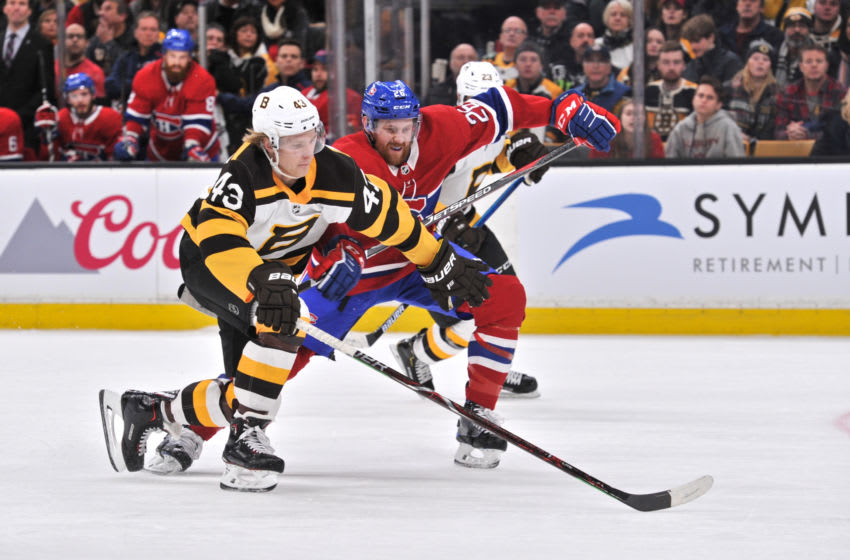 BOSTON, MA - JANUARY 14: Boston Bruins Left Wing Danton Heinen (43) battles Montreal Canadiens Defenceman Jeff Petry (26) for the loose puck. During the Boston Bruins game against the Montreal Canadiens on January 14, 2019 at TD Garden in Boston, MA. (Photo by Michael Tureski/Icon Sportswire via Getty Images)