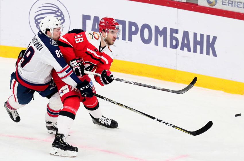 YEKATERINBURG, RUSSIA FEBRUARY 18, 2019: Neftekhimik Nizhnekamsks Arsen Khisamutdinov (L) and Avtomobilist Yekaterinburg's Nikita Tryamkin in their 2018/19 KHL Regular Season ice hockey match at the Uralets Arena; Avtomobilist Yekaterinburg won 5-3. Donat Sorokin/TASS (Photo by Donat SorokinTASS via Getty Images)