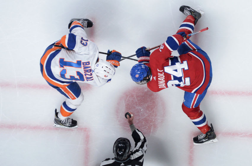 MONTREAL, QC - MARCH 21: Phillip Danault #24 of the Montreal Canadiens and. Mathew Barzal #13 of the New York Islanders face off in the NHL game at the Bell Centre on March 21, 2019 in Montreal, Quebec, Canada. (Photo by Francois Lacasse/NHLI via Getty Images)