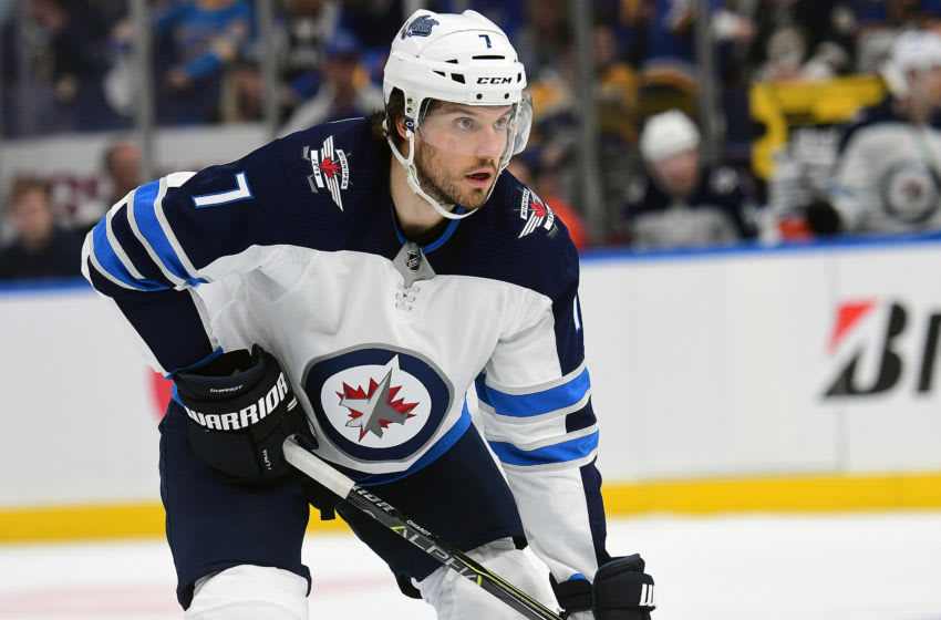 ST. LOUIS, MO - APRIL 20: Winnipeg Jets defenseman Ben Chiarot (7) gets ready to take a face off during a first round Stanley Cup Playoffs game between the Winnipeg Jets and the St. Louis Blues, on April 20, 2019, at Enterprise Center, St. Louis, Mo. (Photo by Keith Gillett/Icon Sportswire via Getty Images)