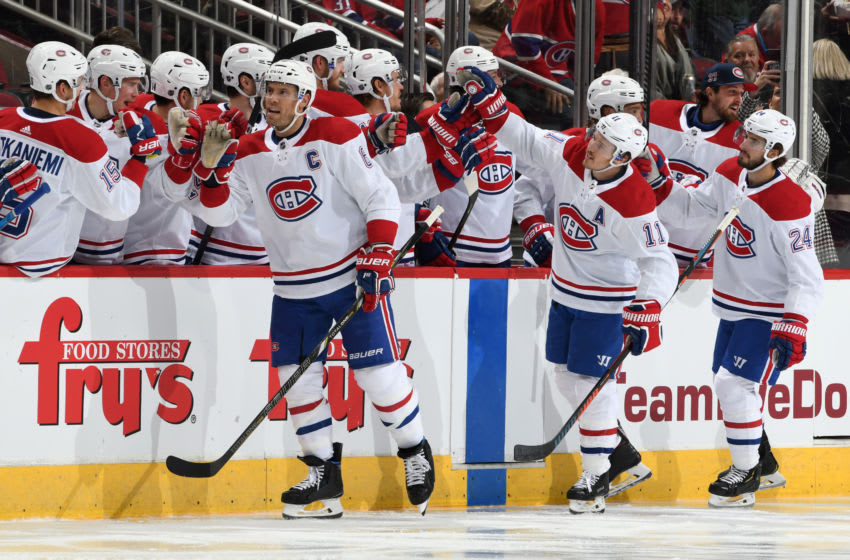 GLENDALE, ARIZONA - OCTOBER 30: Shea Weber #6, Brendan Gallagher #11 and Phillip Danault #24 of the Montreal Canadiens are congratulated by teammates after Weber's goal against the Arizona Coyotes during the second period at Gila River Arena on October 30, 2019 in Glendale, Arizona. (Photo by Norm Hall/NHLI via Getty Images)