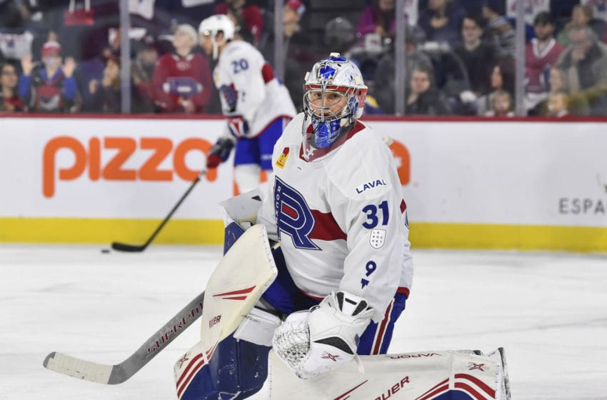 LAVAL, QC - OCTOBER 04: Goaltender Cayden Primeau #31 of the Laval Rocket protects the net during warm-up prior to the game against the Cleveland Monsters at Place Bell on October 4, 2019 in Laval, Canada. The Cleveland Monsters defeated the Laval Rocket 3-2. (Photo by Minas Panagiotakis/Getty Images)