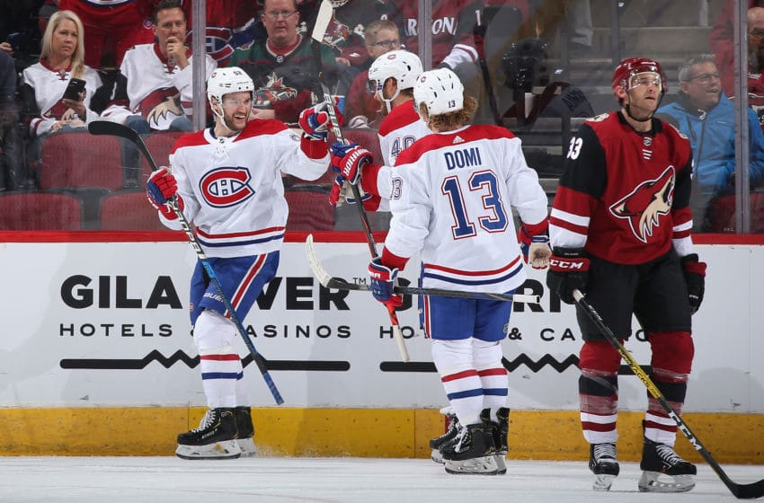 GLENDALE, ARIZONA - OCTOBER 30: Jonathan Drouin #92 of the Montreal Canadiens celebrates with Joel Armia #40 and Max Domi #13 after scoring a goal against the Arizona Coyotes during the third period of the NHL game at Gila River Arena on October 30, 2019 in Glendale, Arizona. The Canadiens defeated the Coyotes 4-1. (Photo by Christian Petersen/Getty Images)