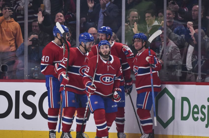 MONTREAL, QC - NOVEMBER 05: Victor Mete #53 of the Montreal Canadiens (C) celebrates a goal with teammates against the Boston Bruins during the first period at the Bell Centre on November 5, 2019 in Montreal, Canada. The Montreal Canadiens defeated the Boston Bruins 5-4. (Photo by Minas Panagiotakis/Getty Images)
