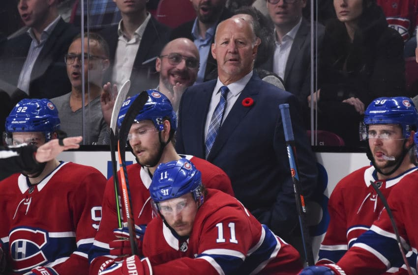 MONTREAL, QC - NOVEMBER 05: Head coach of the Montreal Canadiens Claude Julien looks on from behind the bench as he coaches in his 1,200th career NHL game against the Boston Bruins during the first period at the Bell Centre on November 5, 2019 in Montreal, Canada. The Montreal Canadiens defeated the Boston Bruins 5-4. (Photo by Minas Panagiotakis/Getty Images)