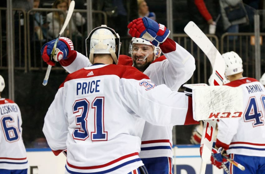 NEW YORK, NY - DECEMBER 06: Nate Thompson #44 and Carey Price #31 of the Montreal Canadiens celebrate after defeating the New York Rangers 2-1 at Madison Square Garden on December 6, 2019 in New York City. (Photo by Jared Silber/NHLI via Getty Images)