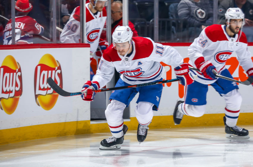 WINNIPEG, MB - DECEMBER 23: Brendan Gallagher #11 of the Montreal Canadiens hits the ice prior to puck drop against the Winnipeg Jets at the Bell MTS Place on December 23, 2019 in Winnipeg, Manitoba, Canada. (Photo by Jonathan Kozub/NHLI via Getty Images)