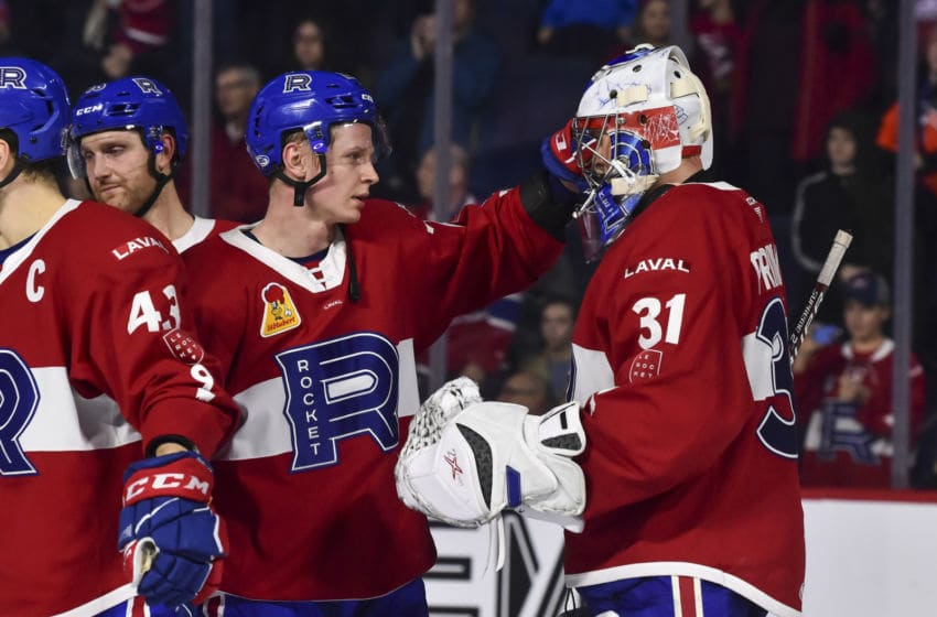 LAVAL, QC - DECEMBER 28: Otto Leskinen #28 and goaltender Cayden Primeau #31 of the Laval Rocket celebrate their victory against the Toronto Marlies at Place Bell on December 28, 2019 in Laval, Canada. The Laval Rocket defeated the Toronto Marlies 6-1. (Photo by Minas Panagiotakis/Getty Images)
