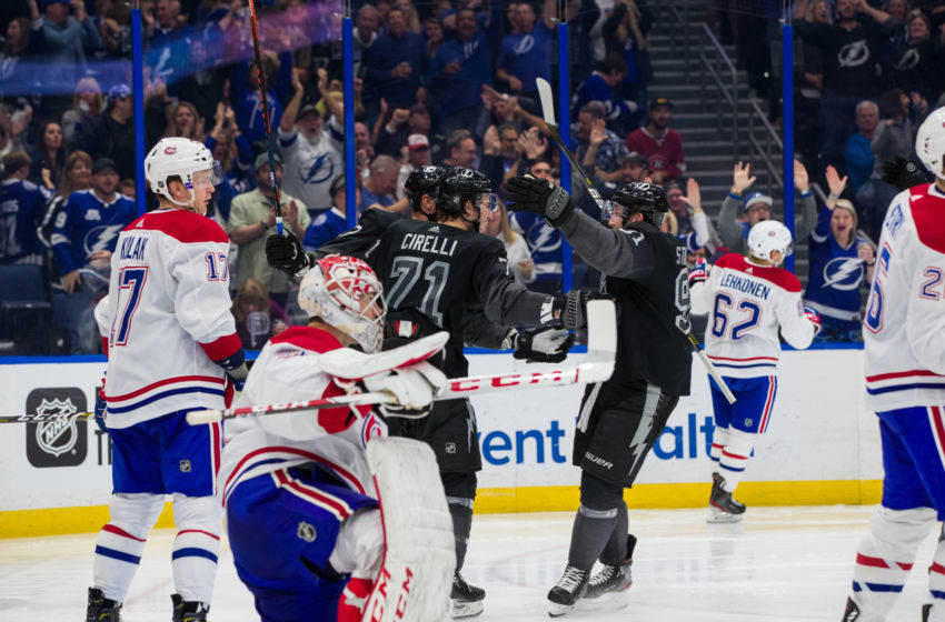TAMPA, FL - DECEMBER 28: Anthony Cirelli #71 of the Tampa Bay Lightning celebrates his goal with teammates Alex Killorn #17 and Steven Stamkos #91 against the Montreal Canadiens during the third period at Amalie Arena on December 28, 2019 in Tampa, Florida (Photo by Mark LoMoglio/NHLI via Getty Images)