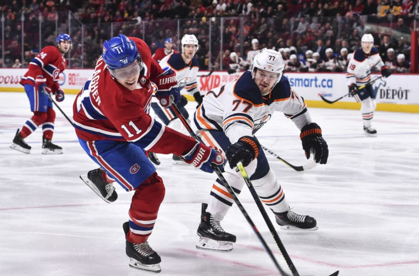 MONTREAL, QC - JANUARY 09: Oscar Klefbom #77 of the Edmonton Oilers tries to block a shot by Brendan Gallagher #11 of the Montreal Canadiens during the second period at the Bell Centre on January 9, 2020 in Montreal, Canada. (Photo by Minas Panagiotakis/Getty Images)