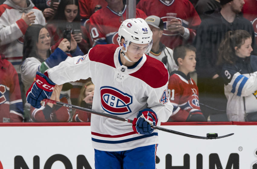 VANCOUVER, BC - DECEMBER 17: Lukas Vejdemo #42 of the Montreal Canadiens plays with the puck during the pre game warm up prior to NHL action against the Vancouver Canucks at Rogers Arena on December 17, 2019 in Vancouver, Canada. (Photo by Rich Lam/Getty Images)