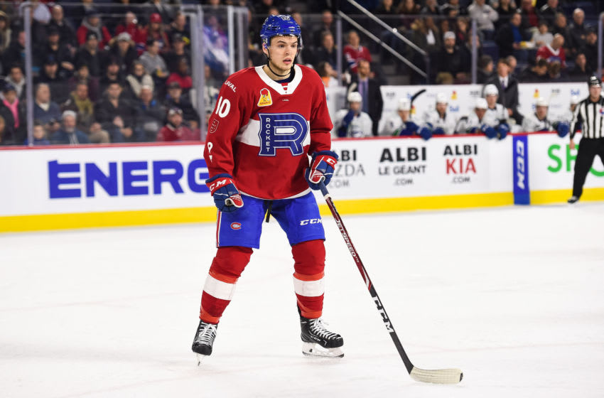 LAVAL, QC - FEBRUARY 05: Laval Rocket center Jake Evans (10) stands watching the play during the Utica Comets versus the Laval Rocket game on February 05, 2020, at Place Bell in Laval, QC (Photo by David Kirouac/Icon Sportswire via Getty Images)