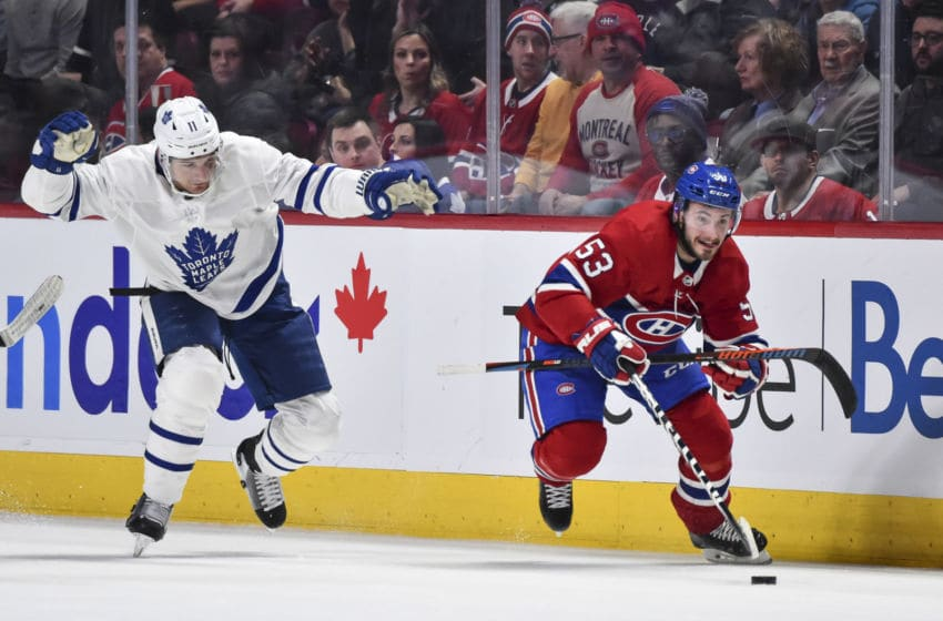 MONTREAL, QC - FEBRUARY 08: Victor Mete #53 of the Montreal Canadiens skates the puck against Zach Hyman #11 of the Toronto Maple Leafs during the second period at the Bell Centre on February 8, 2020 in Montreal, Canada. (Photo by Minas Panagiotakis/Getty Images)