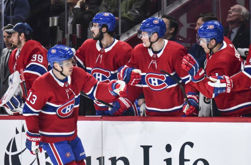 MONTREAL, QC - FEBRUARY 27: Max Domi #13 of the Montreal Canadiens celebrates his goal with teammates on the bench during the first period against the New York Rangers at the Bell Centre on February 27, 2020 in Montreal, Canada. (Photo by Minas Panagiotakis/Getty Images)