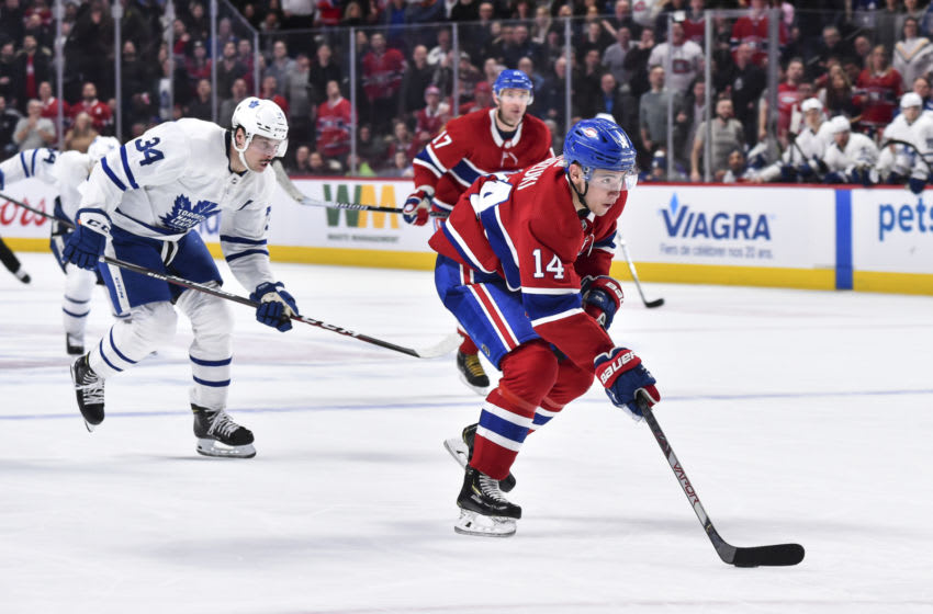 MONTREAL, QC - FEBRUARY 08: Nick Suzuki #14 of the Montreal Canadiens skates the puck in the overtime period against the Toronto Maple Leafs at the Bell Centre on February 8, 2020 in Montreal, Canada. The Montreal Canadiens defeated the Toronto Maple Leafs 2-1 in overtime. (Photo by Minas Panagiotakis/Getty Images)