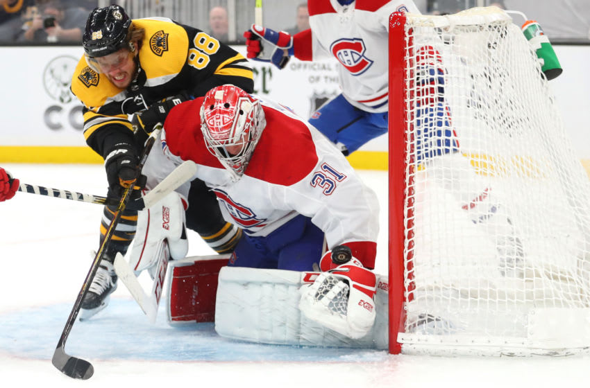 BOSTON, MASSACHUSETTS - FEBRUARY 12: Carey Price #31 of the Montreal Canadiens saves a shot from David Pastrnak #88 of the Boston Bruins during the first period at TD Garden on February 12, 2020 in Boston, Massachusetts. (Photo by Maddie Meyer/Getty Images)