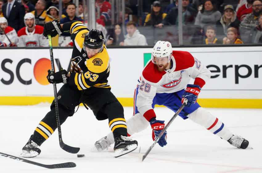 BOSTON, MASSACHUSETTS - FEBRUARY 12: Jeff Petry #26 of the Montreal Canadiens defends Brad Marchand #63 of the Boston Bruins during the first period at TD Garden on February 12, 2020 in Boston, Massachusetts. (Photo by Maddie Meyer/Getty Images)