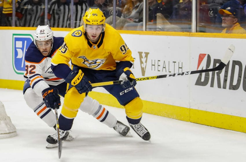 NASHVILLE, TENNESSEE - MARCH 02: Matt Duchene #95 of the Nashville Predators skates against Caleb Jones #82 of the Edmonton Oilers during the third period at Bridgestone Arena on March 02, 2020 in Nashville, Tennessee. (Photo by Frederick Breedon/Getty Images)