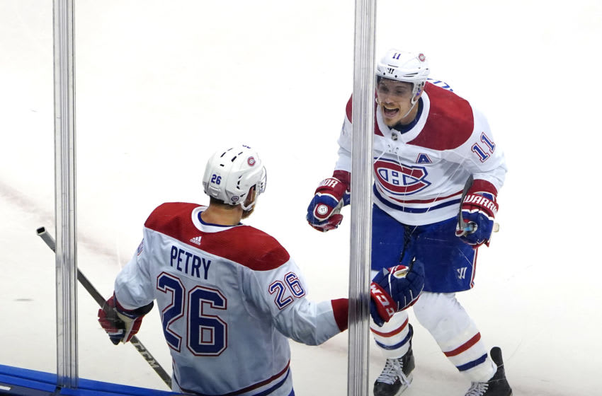 TORONTO, ONTARIO - AUGUST 01: Jeff Petry #26 of the Montreal Canadiens celebrates his game winning goal with teammate Brendan Gallagher #11 in the overtime period against the Pittsburgh Penguins during Game One of the Eastern Conference Qualification Round prior to the 2020 NHL Stanley Cup Playoffs at Scotiabank Arena on August 01, 2020 in Toronto, Ontario. (Photo by Andre Ringuette/Freestyle Photo/Getty Images)