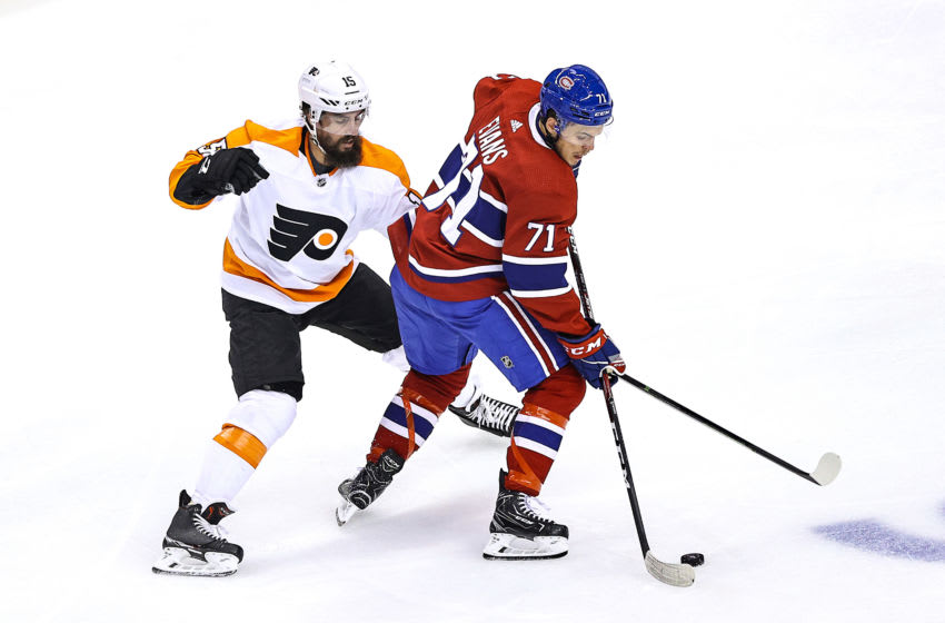 TORONTO, ONTARIO - AUGUST 18: Jake Evans #71 of the Montreal Canadiens is defended by Matt Niskanen #15 of the Philadelphia Flyers during the second period in Game Four of the Eastern Conference First Round during the 2020 NHL Stanley Cup Playoffs at Scotiabank Arena on August 18, 2020 in Toronto, Ontario. (Photo by Elsa/Getty Images)
