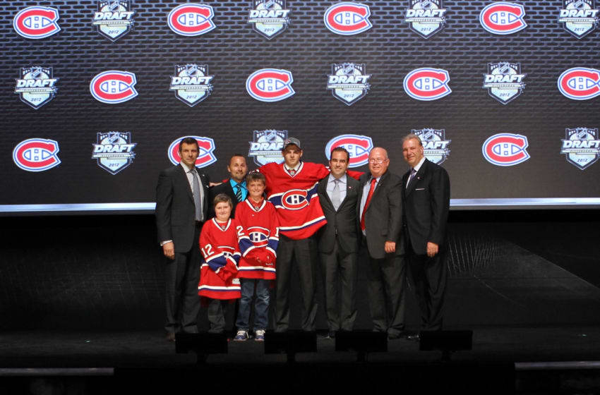PITTSBURGH, PA - JUNE 22: Alex Galchenyuk (C), third overall pick by the Montreal Canadiens, poses with team representatives during Round One of the 2012 NHL Entry Draft at Consol Energy Center on June 22, 2012 in Pittsburgh, Pennsylvania. (Photo by Bruce Bennett/Getty Images)
