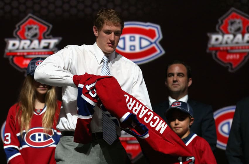 NEWARK, NJ - JUNE 30: Michael McCarron, drafted #25 overall in the first round by the Montreal Canadiens, puts on his new team jersey after he was drafted during the 2013 NHL Draft at the Prudential Center on June 30, 2013 in Newark, New Jersey. (Photo by Bruce Bennett/Getty Images)