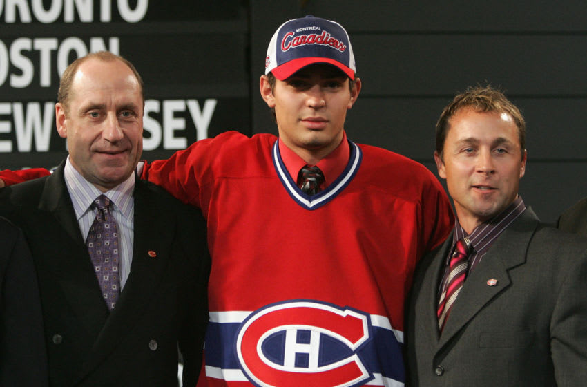 OTTAWA, ONT - JULY 30: Fifth overall draft pick Carey Price of the Montreal Canadiens poses with team general manager Bob Gainey (L) and director of player personnel Trevor Timmins (R) after being selected during the 2005 National Hockey League Draft on July 30, 2005 at the Westin Hotel in Ottawa, Canada. (Photo by Bruce Bennett/Getty Images)