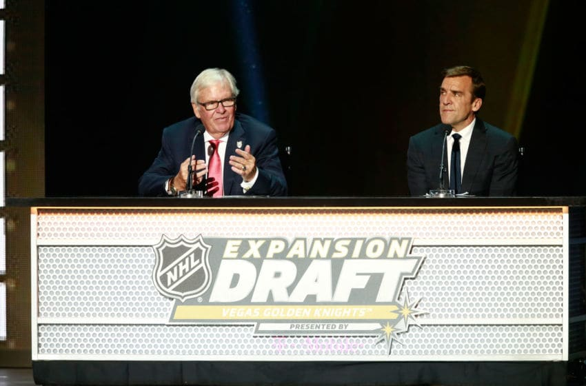 LAS VEGAS, NV - JUNE 21: Co-owner Bill Foley, left, and general manager George McPhee of the Vegas Golden Knights make another selection onstage during the 2017 NHL Awards & Expansion Draft at T-Mobile Arena on June 21, 2017 in Las Vegas, Nevada. (Photo by Jeff Vinnick/NHLI via Getty Images)