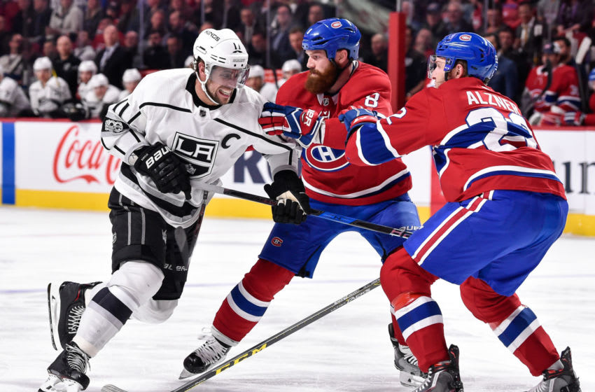 MONTREAL, QC - OCTOBER 26: Anze Kopitar #11 of the Los Angeles Kings tries to squeeze past Jordie Benn #8 and Karl Alzner #22 of the Montreal Canadiens during the NHL game at the Bell Centre on October 26, 2017 in Montreal, Quebec, Canada. The Los Angeles Kings defeated the Montreal Canadiens 4-0. (Photo by Minas Panagiotakis/Getty Images)