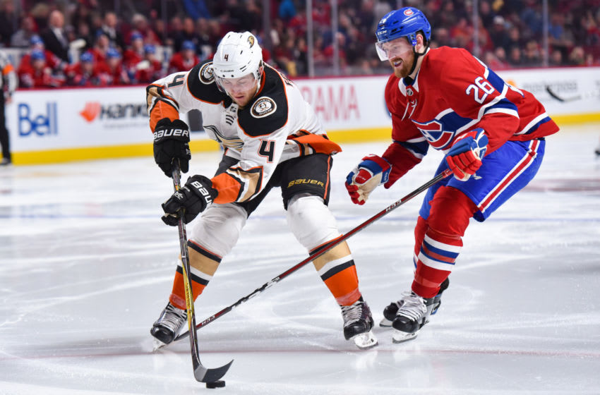 MONTREAL, QC - FEBRUARY 03: Anaheim Ducks Defenceman Cam Fowler (4) gains control of the puck over Montreal Canadiens Defenceman Jeff Petry (26) during the Anaheim Ducks versus the Montreal Canadiens game on February 3, 2018, at Bell Centre in Montreal, QC (Photo by David Kirouac/Icon Sportswire via Getty Images)