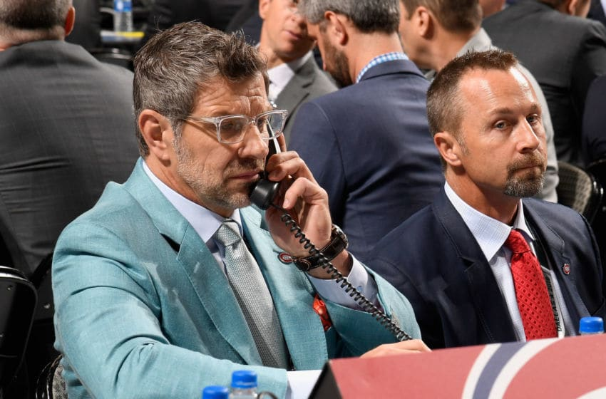 DALLAS, TX - JUNE 23: General manager Marc Bergevin (L) and assistant general manager Trevor Timmins of the Montreal Canadiens look on from the Canadiens draft table during the 2018 NHL Draft at American Airlines Center on June 23, 2018 in Dallas, Texas. (Photo by Brian Babineau/NHLI via Getty Images)
