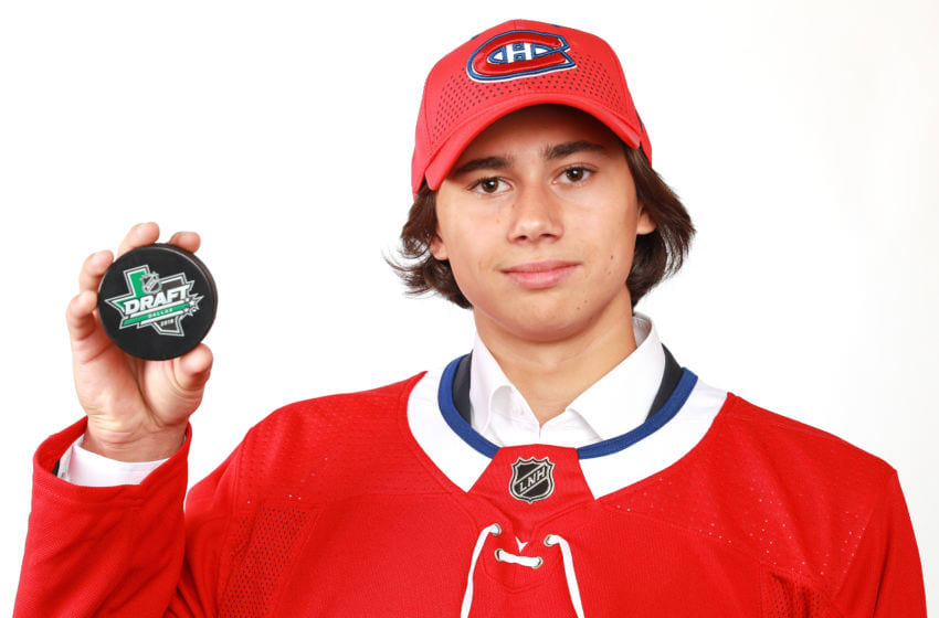 DALLAS, TX - JUNE 23: Alexander Romanov poses after being selected 38th overall by the Montreal Canadiens during the 2018 NHL Draft at American Airlines Center on June 23, 2018 in Dallas, Texas. (Photo by Tom Pennington/Getty Images)