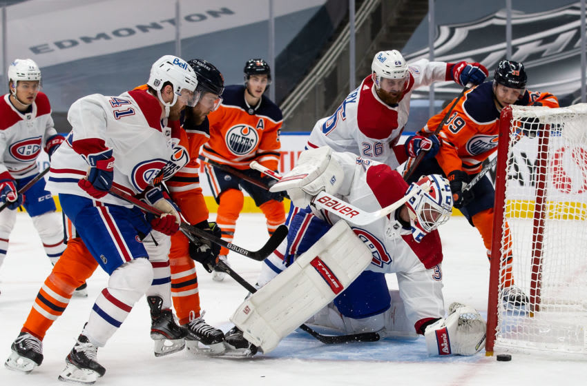 EDMONTON, AB - JANUARY 18: Leon Draisaitl #29 and Alex Chiasson #39 of the Edmonton Oilers look for a shot against goaltender Jake Allen #34 of the Montreal Canadiens at Rogers Place on January 18, 2021 in Edmonton, Canada. (Photo by Codie McLachlan/Getty Images)