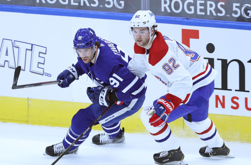 TORONTO, ON - JANUARY 13: Jonathan Drouin #92 of the Montreal Canadiens skates against John Tavares #91 of the Toronto Maple Leafs during an NHL game at Scotiabank Arena on January 13, 2021 in Toronto, Ontario, Canada. The Maple Leafs defeated the Canadiens 5-4 in overtime. (Photo by Claus Andersen/Getty Images)