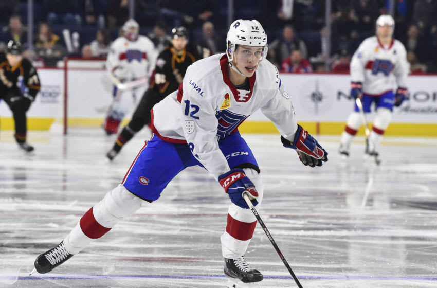 LAVAL, QC - DECEMBER 10: Lukas Vejdemo #12 of the Laval Rocket skates against the Cleveland Monsters during the second period at Place Bell on December 10, 2019 in Laval, Canada. The Laval Rocket defeated the Cleveland Monsters 3-2 in a shootout. (Photo by Minas Panagiotakis/Getty Images)