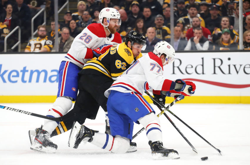 BOSTON, MASSACHUSETTS - FEBRUARY 12: Brett Kulak #77 and Jeff Petry #26 of the Montreal Canadiens (Photo by Maddie Meyer/Getty Images)