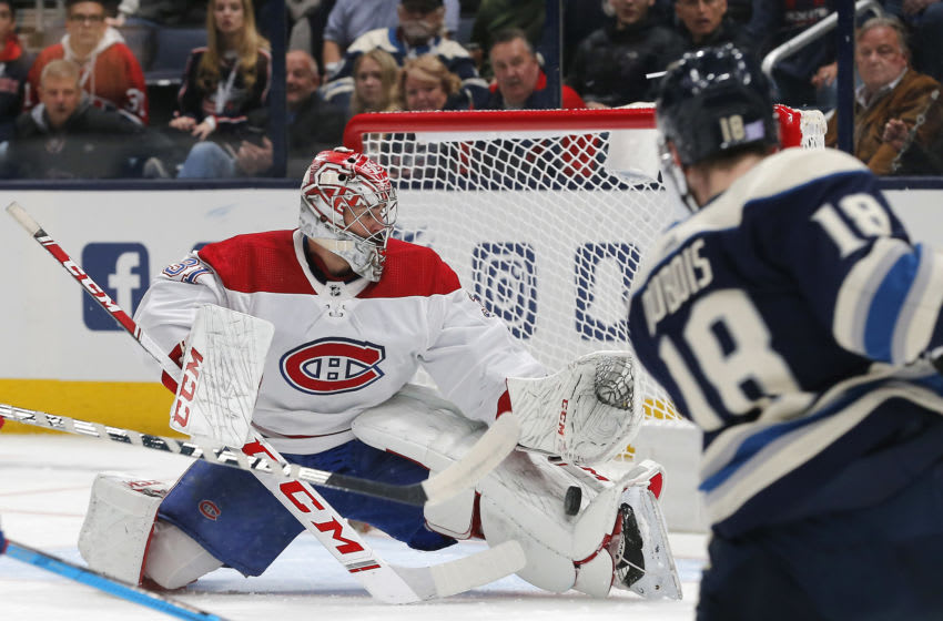 Nov 19, 2019; Columbus, OH, USA; Montreal Canadiens goalie Carey Price (31) makes a pad save from the Columbus Blue Jackets center Pierre-Luc Dubois (18) shot during the first period at Nationwide Arena. Mandatory Credit: Russell LaBounty-USA TODAY Sports